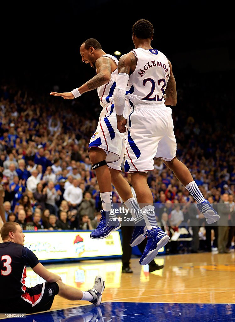 Travis Releford #24 of the Kansas Jayhawks celebrates with Ben McLemore #23 after McLemore scored with an alley-oop dunk at the first half buzzer during the game against the Belmont Bruins at Allen Fieldhouse on December 15, 2012 in Lawrence, Kansas.