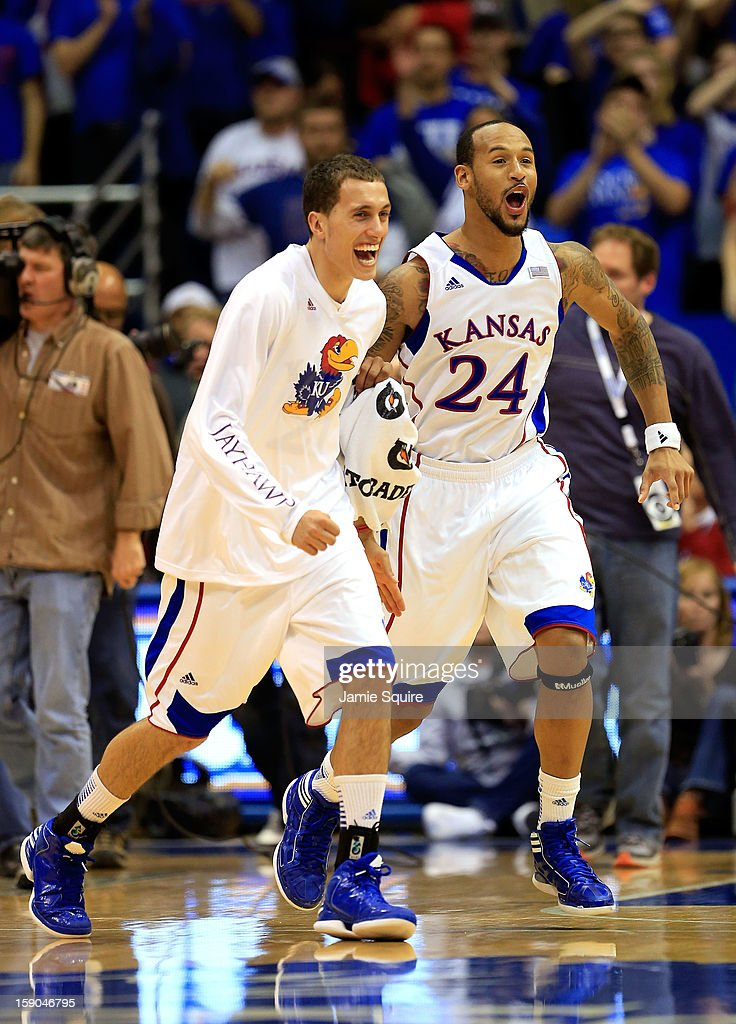 <a gi-track='captionPersonalityLinkClicked' href=/galleries/search?phrase=Travis+Releford&family=editorial&specificpeople=5628041 ng-click='$event.stopPropagation()'>Travis Releford</a> #24 of the Kansas Jayhawks celebrates with teammates after the Jayhawks defeated the Temple Owls Temple Owls win the game at Allen Fieldhouse on January 6, 2013 in Lawrence, Kansas.