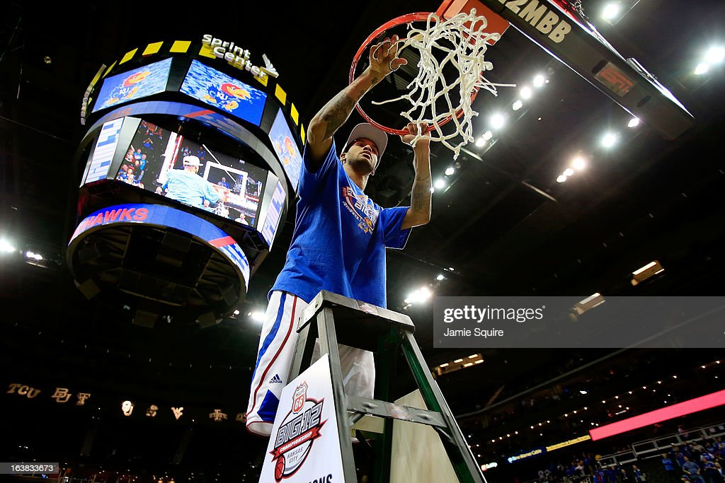 Travis Releford #24 of the Kansas Jayhawks cuts the net in celebration of their 70-54 victory over the Kansas State Wildcats during the Final of the Big 12 basketball tournament at Sprint Center on March 16, 2013 in Kansas City, Missouri.