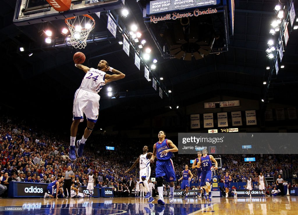 Travis Releford of the Kansas Jayhawks dunks on a fast break during the game against the American University Eagles at Allen Fieldhouse on December...