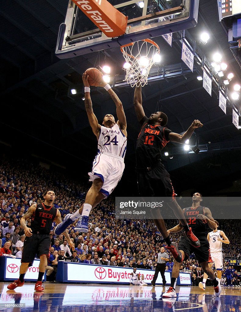 Travis Releford #24 of the Kansas Jayhawks goes up for a basket as Kader Tapsoba #12 of the Texas Tech Red Raiders defends during the game at Allen Fieldhouse on March 4, 2013 in Lawrence, Kansas.