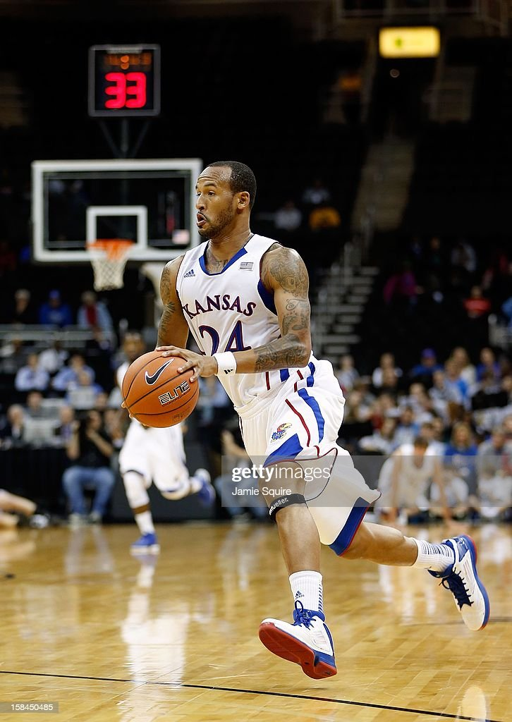 <a gi-track='captionPersonalityLinkClicked' href=/galleries/search?phrase=Travis+Releford&family=editorial&specificpeople=5628041 ng-click='$event.stopPropagation()'>Travis Releford</a> #24 of the Kansas Jayhawks in action during the CBE Hall of Fame Classic against the Washington State Cougars at the Sprint Center on November 19, 2012 in Kansas City, Missouri.