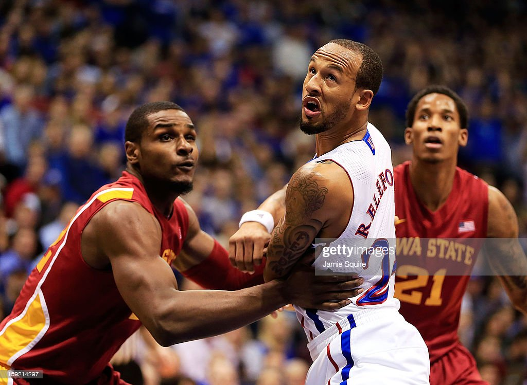 <a gi-track='captionPersonalityLinkClicked' href=/galleries/search?phrase=Travis+Releford&family=editorial&specificpeople=5628041 ng-click='$event.stopPropagation()'>Travis Releford</a> #24 of the Kansas Jayhawks jockeys for a rebound during the game against the Iowa State Cyclones at Allen Fieldhouse on January 9, 2013 in Lawrence, Kansas.
