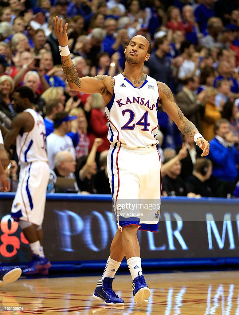 Travis Releford #24 of the Kansas Jayhawks motions to the crowd during the game against the Texas Tech Red Raiders at Allen Fieldhouse on March 4, 2013 in Lawrence, Kansas.