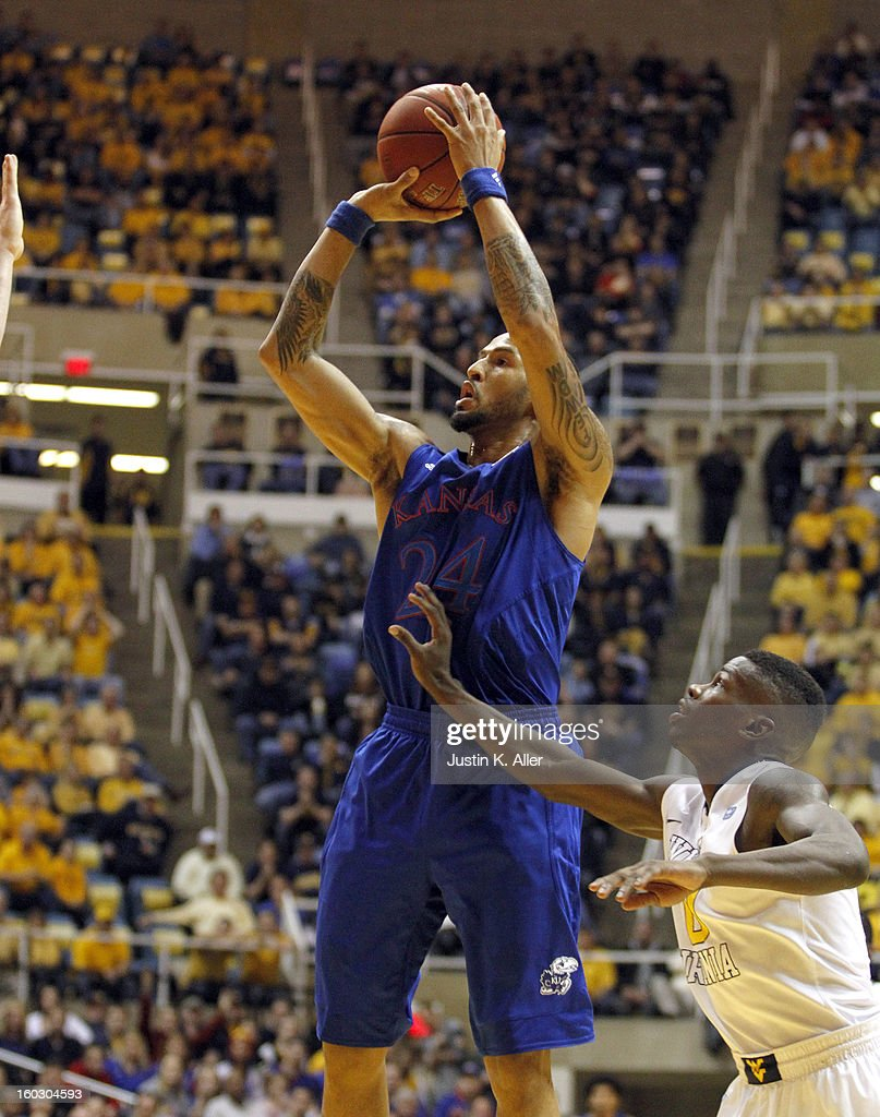 Travis Releford #24 of the Kansas Jayhawks pulls up against the West Virginia Mountaineers at the WVU Coliseum on January 28, 2013 in Morgantown, West Virginia.