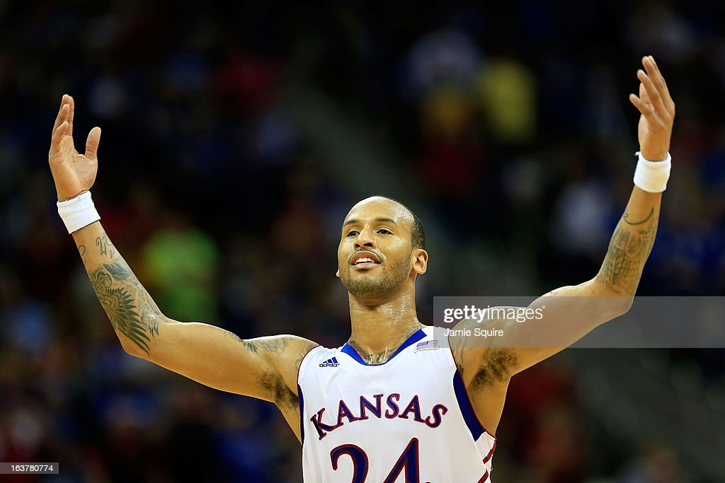 <a gi-track='captionPersonalityLinkClicked' href=/galleries/search?phrase=Travis+Releford&family=editorial&specificpeople=5628041 ng-click='$event.stopPropagation()'>Travis Releford</a> #24 of the Kansas Jayhawks reacts during the second half of the game against the Iowa State Cyclones in the Semifinals of the Big 12 basketball tournament at the Sprint Center on March 15, 2013 in Kansas City, Missouri. Kansas won 88-73 over Iowa State.