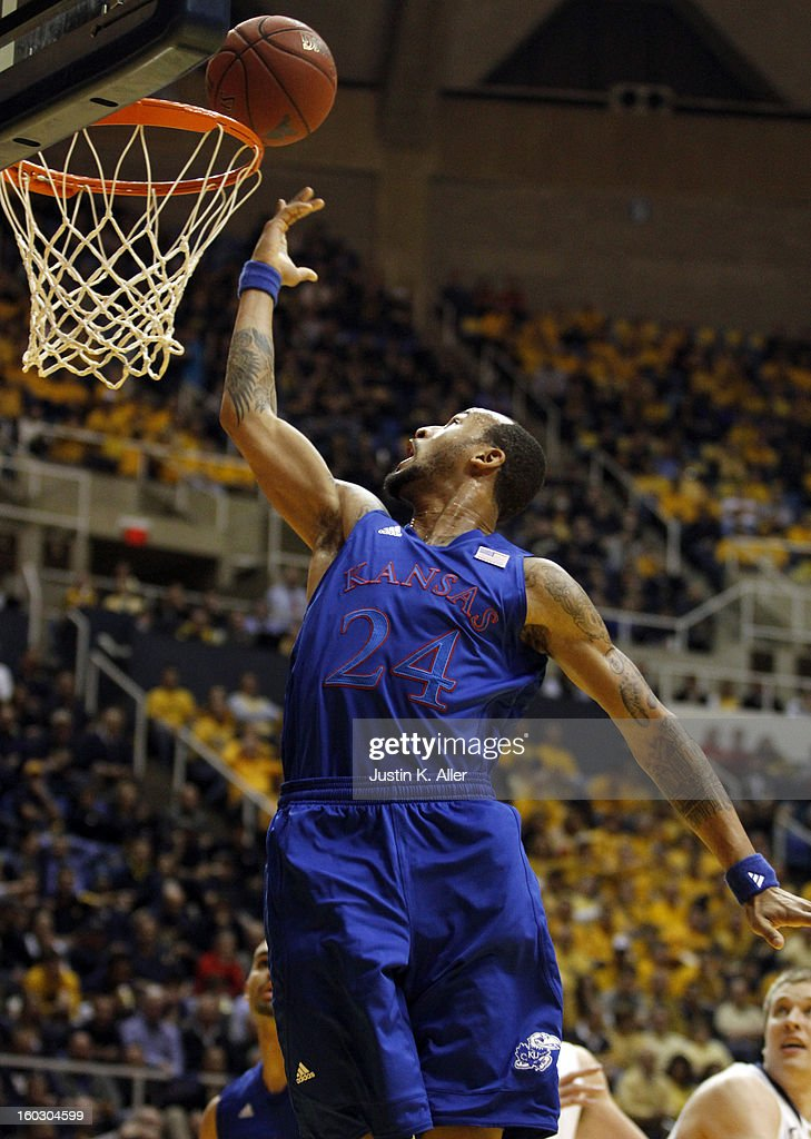 Travis Releford #24 of the Kansas Jayhawks rolls one in against the West Virginia Mountaineers at the WVU Coliseum on January 28, 2013 in Morgantown, West Virginia.