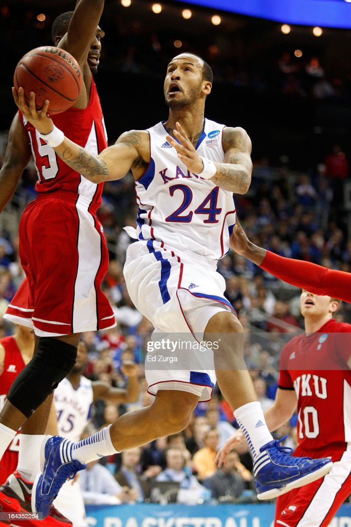 <a gi-track='captionPersonalityLinkClicked' href=/galleries/search?phrase=Travis+Releford&family=editorial&specificpeople=5628041 ng-click='$event.stopPropagation()'>Travis Releford</a> #24 of the Kansas Jayhawks shoots against O'Karo Akamune #15 and Caden Dickerson #10 of the Western Kentucky Hilltoppers in the first half during the second round of the 2013 NCAA Men's Basketball Tournament at the Sprint Center on March 22, 2013 in Kansas City, Missouri.