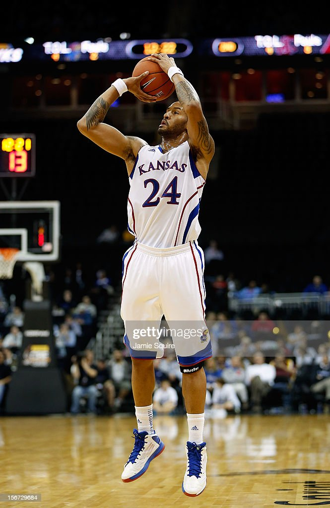 Travis Releford #24 of the Kansas Jayhawks shoots during the CBE Hall of Fame Classic game against the Washington State Cougars at Sprint Center on November 19, 2012 in Kansas City, Missouri.