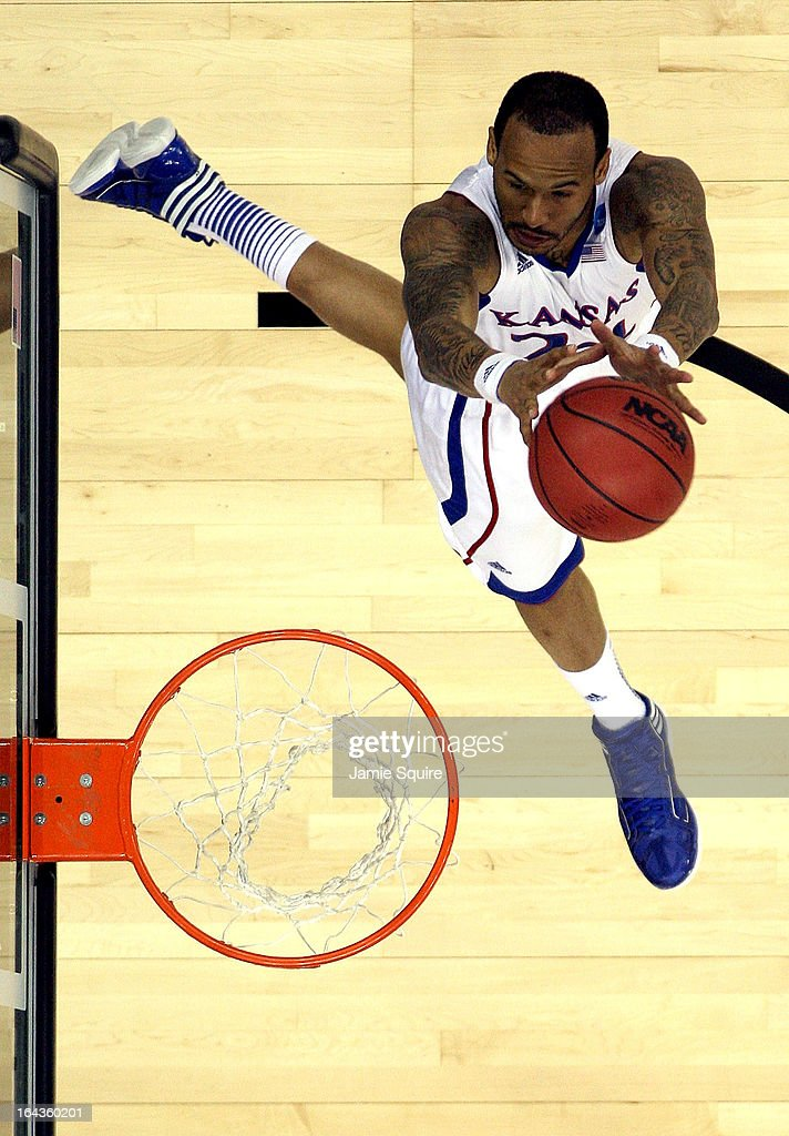 <a gi-track='captionPersonalityLinkClicked' href=/galleries/search?phrase=Travis+Releford&family=editorial&specificpeople=5628041 ng-click='$event.stopPropagation()'>Travis Releford</a> #24 of the Kansas Jayhawks shoots during the second round of the NCAA Basketball Tournament against the Western Kentucky Hilltoppers at the Sprint Center on March 22, 2013 in Kansas City, Missouri.
