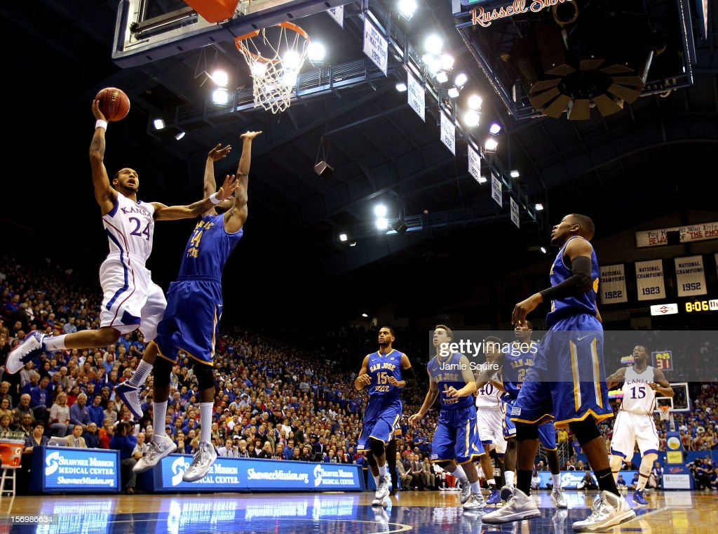 Travis Releford of the Kansas Jayhawks shoots over the San Jose State Spartans during the game at Allen Fieldhouse on November 26 2012 in Lawrence...