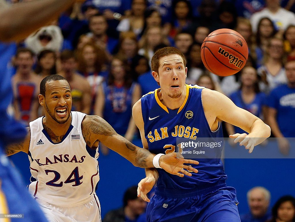 Travis Releford of the Kansas Jayhawks steals the ball from Mike VanKirk of the San Jose State Spartans during the game at Allen Fieldhouse on...