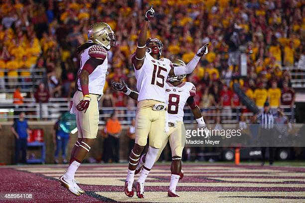 Travis Rudolph of the Florida State Seminoles celebrates with Kermit Whitfield and Ermon Lane of the Florida State Seminoles after scoring a...
