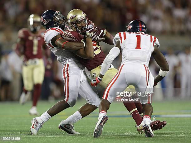 Travis Rudolph of the Florida State Seminoles is tackled in the second half against the Mississippi Rebels during the Camping World Kickoff at...