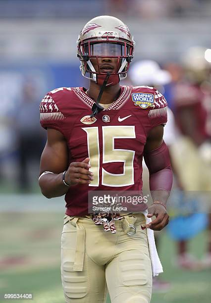 Travis Rudolph of the Florida State Seminoles looks on prior to the Camping World Kickoff against the Mississippi Rebels at Camping World Stadium on...