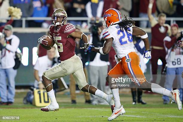 Travis Rudolph of the Florida State Seminoles outruns Marcell Harris of the Florida Gators for a 46yard touchdown in the third quarter of the game at...