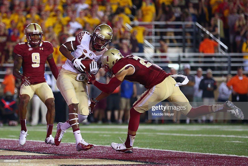 Travis Rudolph #15 of the Florida State Seminoles scores a touchdown with pressure from Justin Simmons #27 of the Boston College Eagles during the first half at Alumni Stadium on September 18, 2015 in Chestnut Hill, Massachusetts.