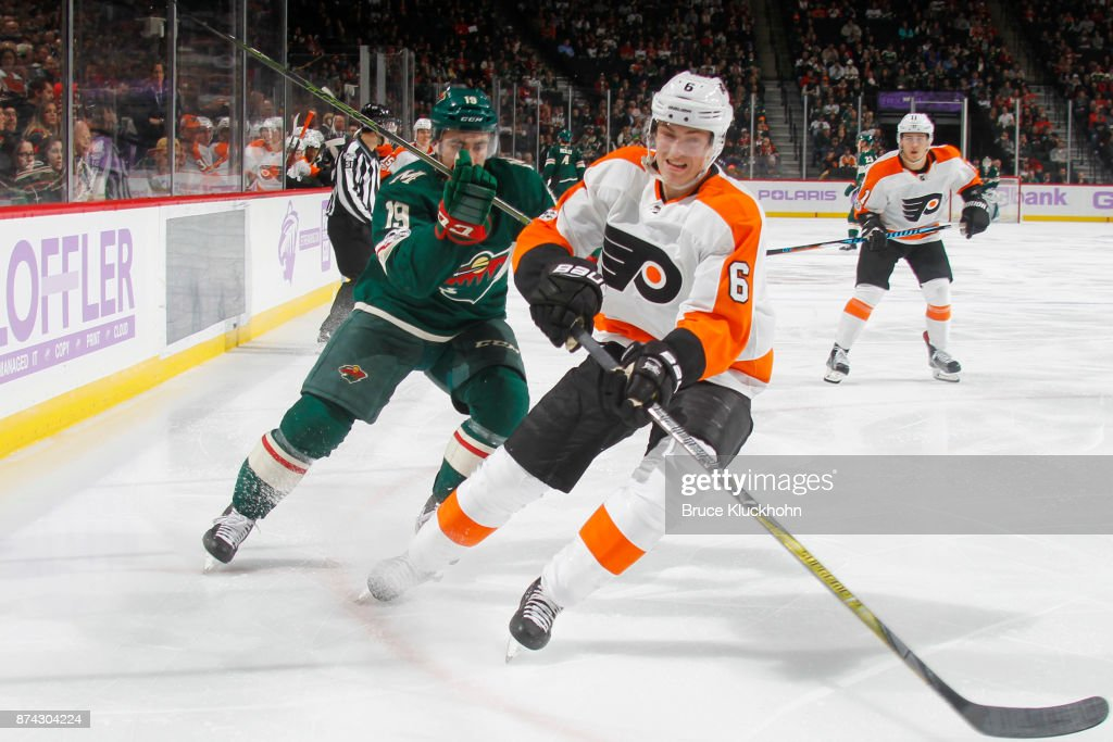 Travis Sanheim #6 of the Philadelphia Flyers skates to the puck with Luke Kunin #19 of the Minnesota Wild defending during the game at the Xcel Energy Center on November 14, 2017 in St. Paul, Minnesota.