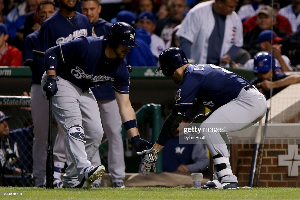 Travis Shaw #21 and Ryan Braun #8 of the Milwaukee Brewers celebrate after Braun hit his 300th career home run in the first inning against the Chicago Cubs at Wrigley Field on September 8, 2017 in Chicago, Illinois.
