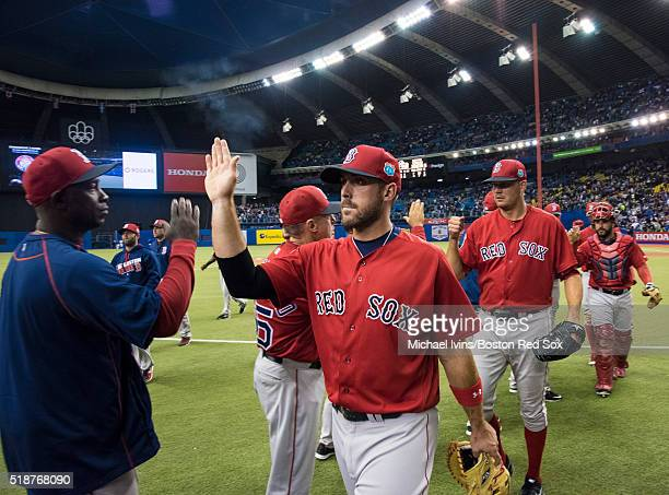 Travis Shaw of the Boston Red Sox celebrates a victory over the Toronto Blue Jays on April 2 2016 at Olympic Stadium in Montreal Quebec
