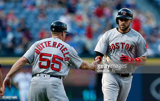 Travis Shaw of the Boston Red Sox celebrates with Brian Butterfield of the Boston Red Sox as he rounds third base after hitting a three run home run...