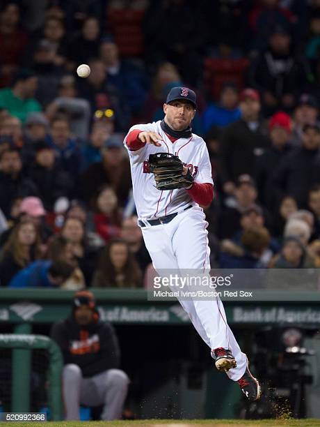 Travis Shaw of the Boston Red Sox completes a put out against the Baltimore Orioles in the second inning on April 13 2016 at Fenway Park in Boston...