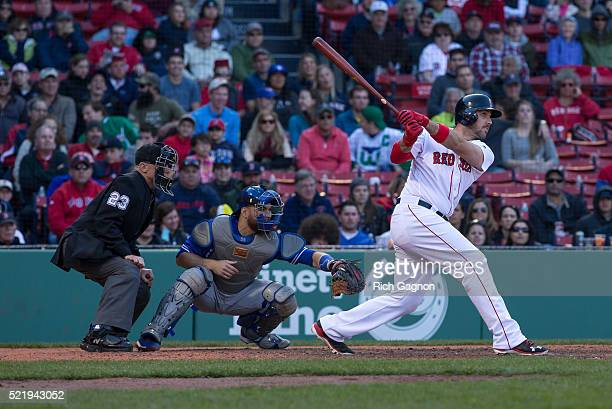 Travis Shaw of the Boston Red Sox hits a home run during the ninth inning against the Toronto Blue Jays at Fenway Park on April 17 2016 in Boston...