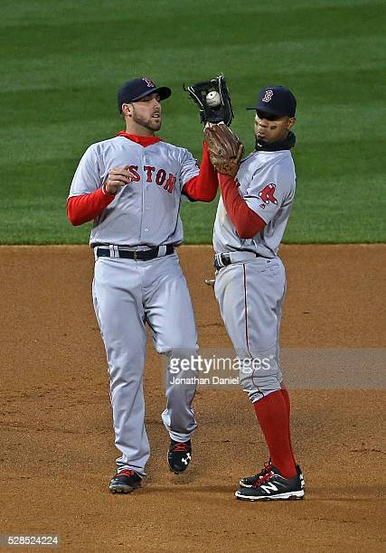 Travis Shaw of the Boston Red Sox makes a catch as Xander Bogaerts avoids the collision against the Chicago White Sox in the 2nd inning at US...