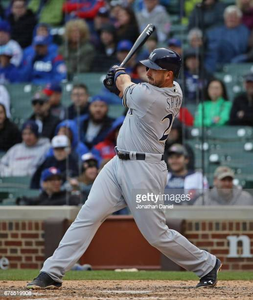Travis Shaw of the Milwaukee Brewers bats against the Chicago Cubs at Wrigley Field on April 19 2017 in Chicago Illinois The Cubs defeated the...