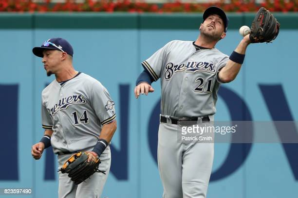 Travis Shaw of the Milwaukee Brewers cannot make a catch as he errors on a ball hit by Jose Lobaton of the Washington Nationals during the sixth...