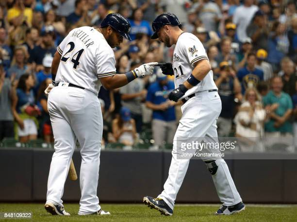 Travis Shaw of the Milwaukee Brewers celebrates his home run with Jesus Aguilar during the sixth inning of their game against the Miami Marlins at...