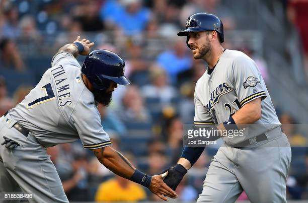 Travis Shaw of the Milwaukee Brewers celebrates his three run home run with Eric Thames during the third inning against the Pittsburgh Pirates at PNC...