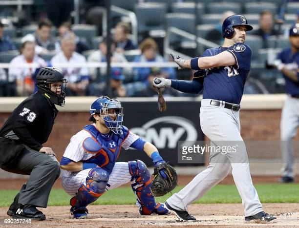Travis Shaw of the Milwaukee Brewers drives in a run in the first inning as Travis d'Arnaud of the New York Mets defends on May 30 2017 at Citi Field...