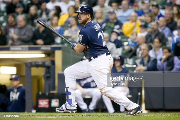 Travis Shaw of the Milwaukee Brewers hits a double in the fourth inning against the Colorado Rockies at Miller Park on April 4 2017 in Milwaukee...