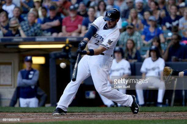 Travis Shaw of the Milwaukee Brewers hits a grand slam in the seventh inning against the Los Angeles Dodgers at Miller Park on June 3 2017 in...