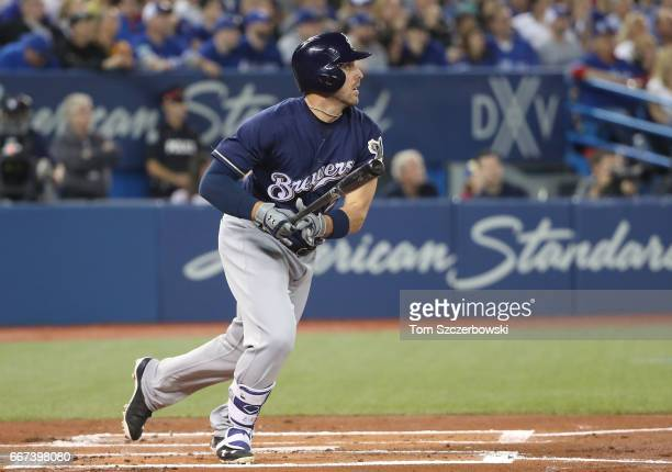 Travis Shaw of the Milwaukee Brewers hits a triple in the first inning during MLB game action against the Toronto Blue Jays at Rogers Centre on April...