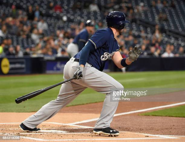 Travis Shaw of the Milwaukee Brewers hits an RBI single during the first inning of a baseball game against the San Diego Padres at PETCO Park on May...