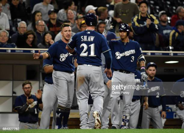 Travis Shaw of the Milwaukee Brewers is congratulated after scoring during the ninth inning of a baseball game against the San Diego Padres at PETCO...