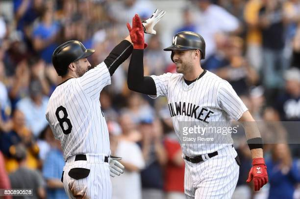 Travis Shaw of the Milwaukee Brewers is congratulated by Ryan Braun following a three run home run during the first inning against the Cincinnati...