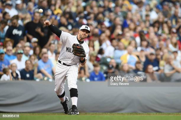 Travis Shaw of the Milwaukee Brewers makes a throw to first base during the third inning against the Cincinnati Reds at Miller Park on August 12 2017...