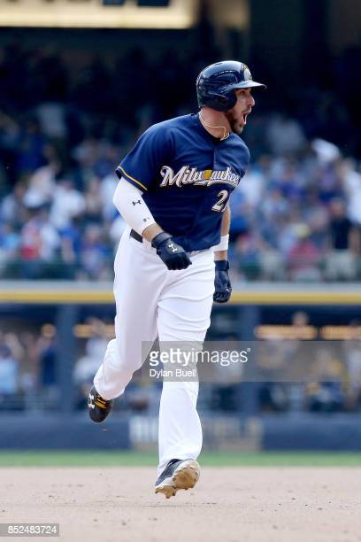 Travis Shaw of the Milwaukee Brewers reacts after hitting a walk off home run to beat the Chicago Cubs 43 in ten innings at Miller Park on September...