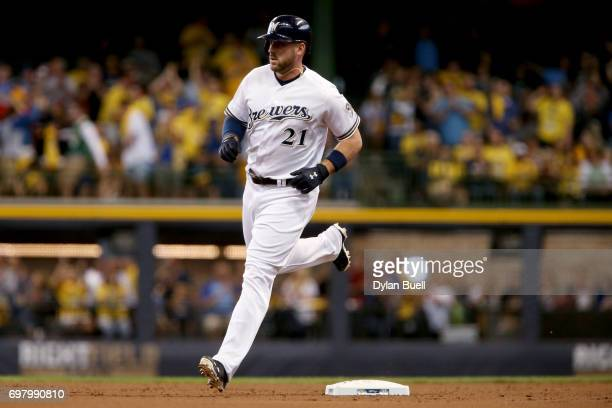 Travis Shaw of the Milwaukee Brewers rounds the bases after hitting a home run in the second inning against the Pittsburgh Pirates at Miller Park on...