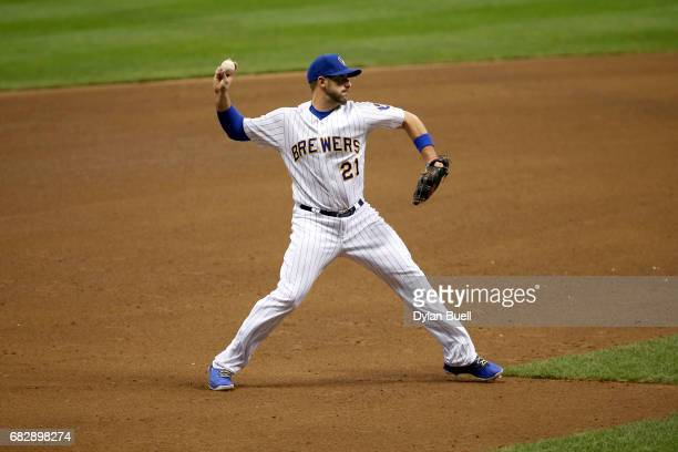 Travis Shaw of the Milwaukee Brewers throws to first base in the fifth inning against the New York Mets at Miller Park on May 12 2017 in Milwaukee...