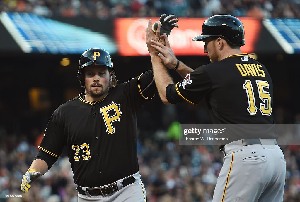 <a gi-track='captionPersonalityLinkClicked' href=/galleries/search?phrase=Travis+Snider&family=editorial&specificpeople=4959427 ng-click='$event.stopPropagation()'>Travis Snider</a> #23 and <a gi-track='captionPersonalityLinkClicked' href=/galleries/search?phrase=Ike+Davis&family=editorial&specificpeople=2349664 ng-click='$event.stopPropagation()'>Ike Davis</a> #15 of the Pittsburgh Pirates celebrates after Snider hit a two-run homer against the San Francisco Giants in the top of the second inning at AT&T Park on July 29, 2014 in San Francisco, California. Davis was on base when Snider hit the home run.