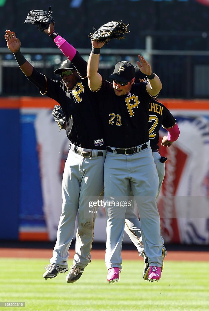 <a gi-track='captionPersonalityLinkClicked' href=/galleries/search?phrase=Travis+Snider&family=editorial&specificpeople=4959427 ng-click='$event.stopPropagation()'>Travis Snider</a> #23 and <a gi-track='captionPersonalityLinkClicked' href=/galleries/search?phrase=Starling+Marte&family=editorial&specificpeople=7934200 ng-click='$event.stopPropagation()'>Starling Marte</a> #6 of the Pittsburgh Pirates celebrates the win over the New York Mets on May 12, 2013 at Citi Field in the Flushing neighborhood of the Queens borough of New York City. The Pittsburgh Pirates defeated the New York Mets 3-2.