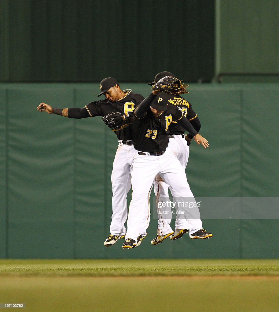 Travis Snider #23, Jose Tabata #31 and Andrew McCutchen #22 of the Pittsburgh Pirates celebrate after winning against the Atlanta Braves on April 19, 2013 at PNC Park in Pittsburgh, Pennsylvania.