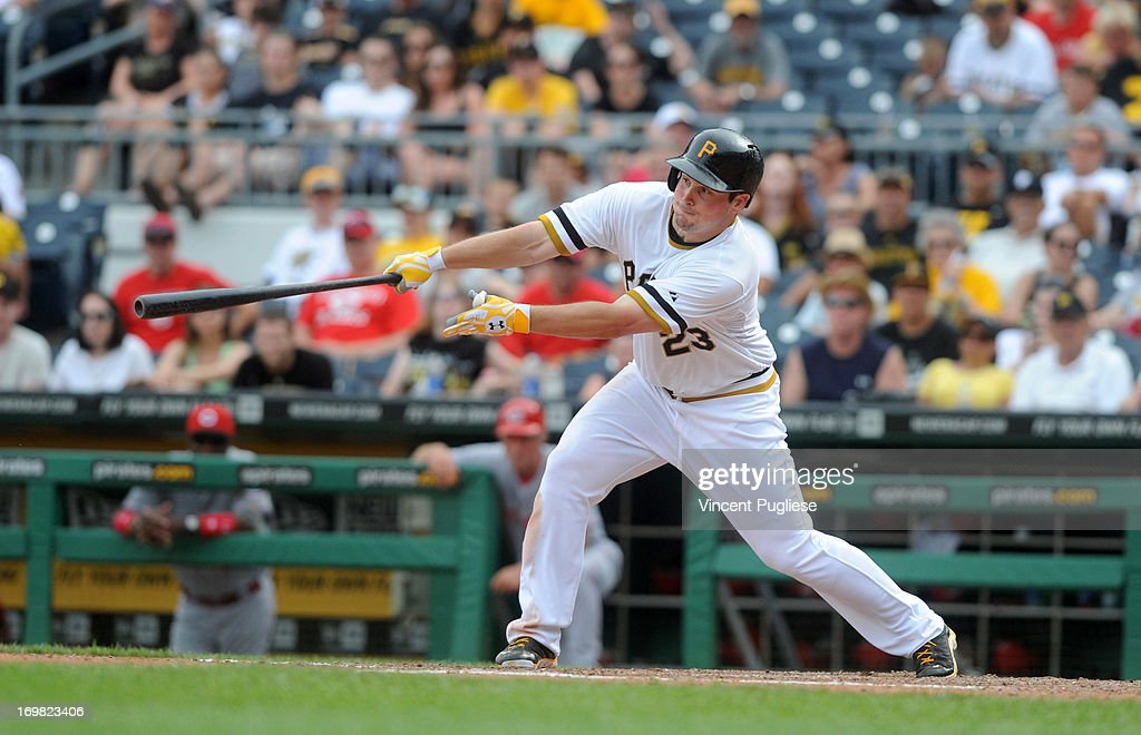 <a gi-track='captionPersonalityLinkClicked' href=/galleries/search?phrase=Travis+Snider&family=editorial&specificpeople=4959427 ng-click='$event.stopPropagation()'>Travis Snider</a> #23 of the Pittsburgh Pirates bloops a single to drive in the winning run in the eleventh inning to defeat the the Cincinnati Reds 5-4 at PNC Park on June 2, 2013 in Pittsburgh, Pennsylvania.