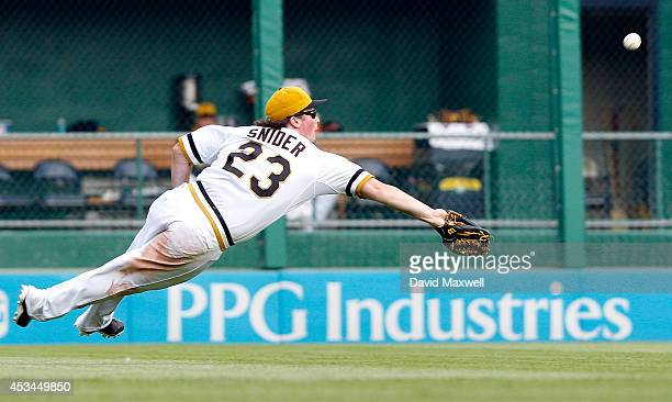 Travis Snider of the Pittsburgh Pirates can't catch a ball hit by Tommy Medica of the San Diego Padres during the eighth inning of their game on...