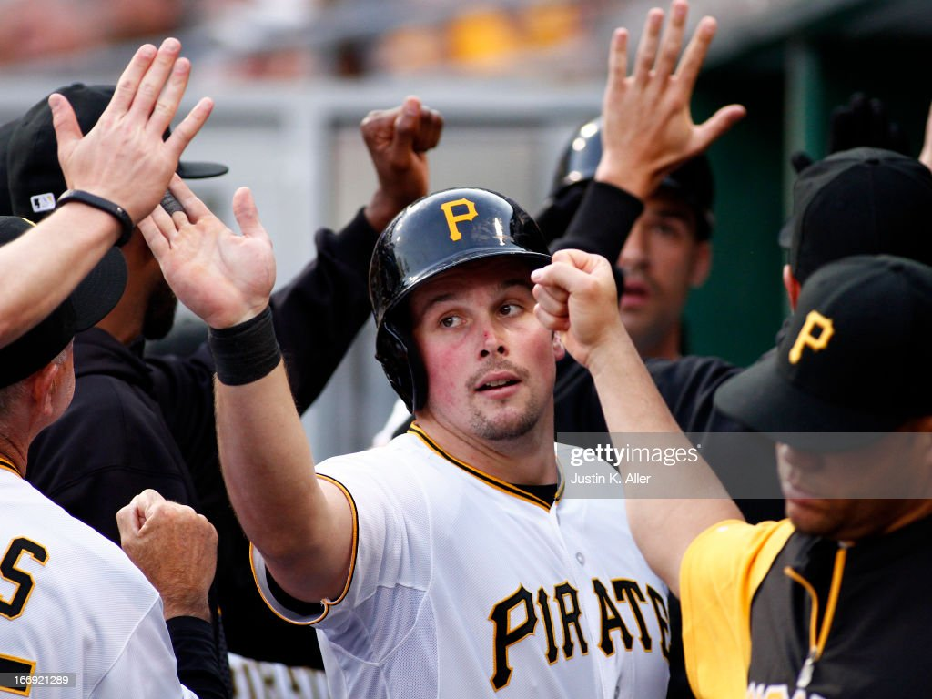 <a gi-track='captionPersonalityLinkClicked' href=/galleries/search?phrase=Travis+Snider&family=editorial&specificpeople=4959427 ng-click='$event.stopPropagation()'>Travis Snider</a> #23 of the Pittsburgh Pirates celebrates after scoring on a Garrett Jones (not pictured) sacrifice fly in the first inning against the Atlanta Braves on April 18, 2013 at PNC Park in Pittsburgh, Pennsylvania.