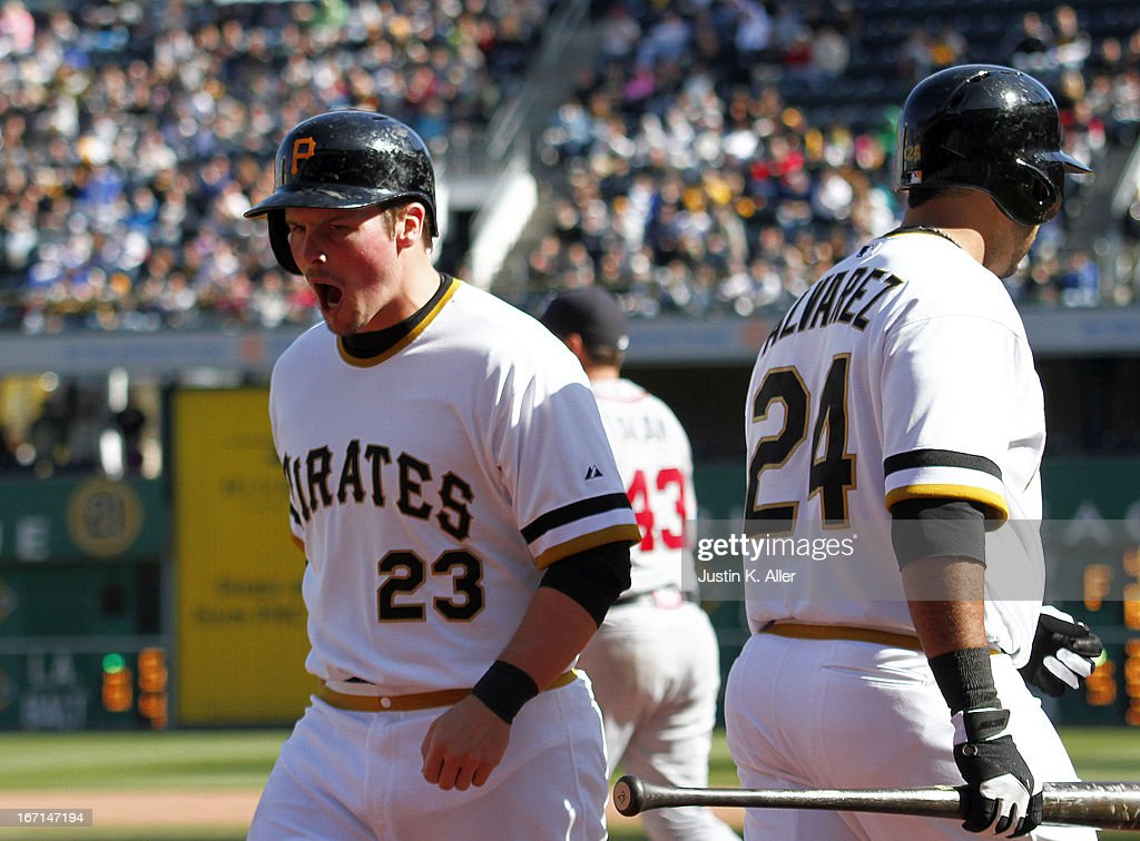 <a gi-track='captionPersonalityLinkClicked' href=/galleries/search?phrase=Travis+Snider&family=editorial&specificpeople=4959427 ng-click='$event.stopPropagation()'>Travis Snider</a> #23 of the Pittsburgh Pirates celebrates after scoring on a wild pitch in the seventh inning by Luis Avilan #43 of the Atlanta Braves (not pictured) during the game on April 21, 2013 at PNC Park in Pittsburgh, Pennsylvania. The Pirates defeated the Braves 4-2.